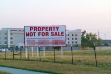 Photo of a billboard that reads Property NOT For Sale